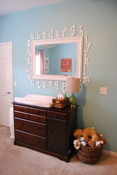 Like the non changing table idea with wicker baskets and a hanging mirror for a nursery