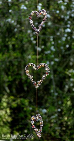 Earthy Love Heart Hanging Ornament - A patina copper triple hanging decoration with three mini love heart shapes wrapped with agate and quartz beads. Hanging art for homes and gardens. The design was inspired by an earthy woodland colour palette, muted and harmonious tones of browns and black with hints of red and copper. A hand crafted piece made by Nicola Jones in her Horsham studio, West Sussex.