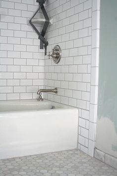 White subway tiles with grey grout. LOVE!