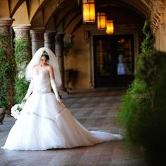 Ivory ballgown with a corset top and silli arm sleeves | One Fine Day Photography | villasiena.cc
