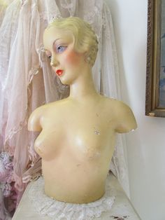 This is an absolutely gorgeous, really large, and oh so rare 1930s lady mannequin display bust! She is a half bust. She would have been used as a