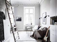 Beautiful Swedish studio where a little goes a long way (ladder access to a loft bed over the bathroom)