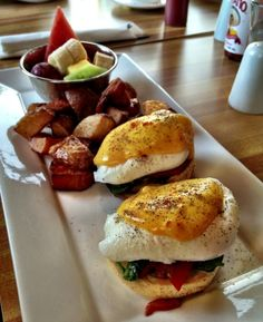 ◾Capicollo Eggs Benedict – Eggs Benedict with pesto and tomatoes topped with hollandaise sauce served with hash browns and a bowl of fruit
