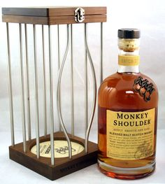 The bottle is in a twisted bars cage. It allegently contained a strong monkey, which match with the brand's willing to offer a whisky with a both strong taste and subtle (monkey's mischievousness) taste. There is a booklet with the cocktails you could do : useful aspect but also to say Monkey Shoulder's taste is different, which makes it rare and precious