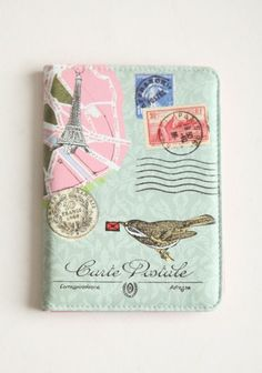 see the world passport holder  $28.99  Travel out of the country knowing your passport is safe in this darling passport holder. Decorated with a vintage flair with European designs, with an elastic band down the middle inside, corner tabs on the right side, and a half page pouch on the left side to hold extra items.