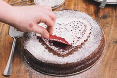 Use a doily to decorate a cake with powdered sugar. I've done this before, and it looked elegant (yet simple).