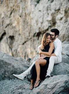 These dreamy, romantic engagement photos in Northern Italy are seriously swoon worthy. Let us set the scene for you; there's a beautiful rocky beach on the Italian coast, a couple that are just days away from saying 'I Do', and just the right amount of sunlight