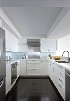 ... FULL ARTICLE @ http://www.centralfurnitures.com/675/amazing-and-bright-modern-kitchens.html/steel-and-wood-with-white-wall-decor/