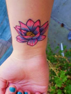 Blue Pink Lotus flower tattoo - wrist