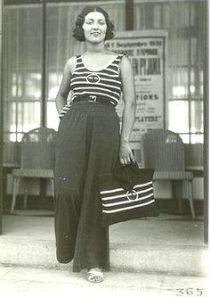 Biarritz 1931 by Séeberger casual beach resort wear wide leg trouser pants, t-shirt top, and knit handbag.