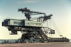 Ferropolis, graveyard of gigantic machines. This is another reason why I have to visit Germany.
