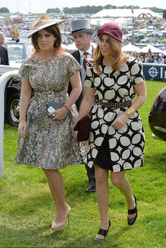 (L-R) Princess Eugenie chose a summery dress with a full-skirt, while her sister Princess Beatrice opted for a more unusual black and white number with a maroon hat, 6/1/13.