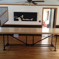In need of a long, narrow dining table, this homeowner topped a base of threaded pipe and and standard fittings with a piece of salvaged bowling alley. Narrow Dining Tables, Diy Dining Room Table, Small Dining, Kitchen Tables, Pipe Furniture, Furniture Projects, Home Projects, Cool Furniture, Diy Esstisch