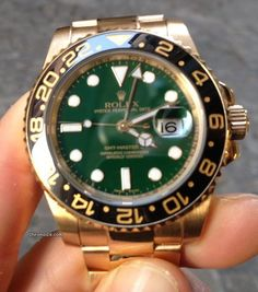 Rolex GMT II 116718 with Green Dial