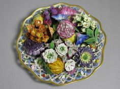 Meissen 19th Century A TROMPE L'OEIL DISH FILLED WITH FLOWERS
