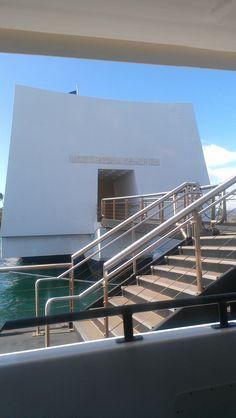 Visitors take a boat to the USS Arizona Memorial in Pearl Harbor.