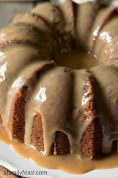 Toffee Pecan Bundt Cake with Caramel Drizzle - A moist and delicious cake that is filled with toffee bits and pecans with an amazing caramel drizzle frosting!