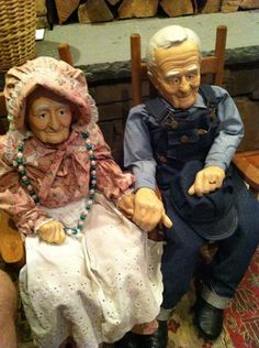 """This special find, had to buy them! An old man and old woman dressed in country attire. These 32"""" OOAK dolls sit on their rocking chairs enjoying the married life. Bisque faces, hands, legs and feet. Love the details -- wedding rings, hats, necklace, overalls, sparkle in their eyes..."""