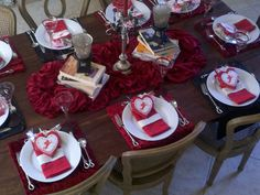 "Table top before the party starts.  Used books book club has read as base to candle ""centerpiece."" Pane velvet table cloth,"