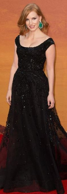 Who made Jessica Chastain's black gown and green jewelry?