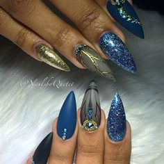 Almond shaped nails with blue and gold gel polishes and black and gold line art with transfer foil. Blue and gold shimmers. Beautiful nails by Ugly Duckling family member and Exclusive Ambassador @nailsbyquetel ❤️ Using Ugly Ducklings Gel Polish #111 Matte topcoat and No Wipe topcoat Ugly Duckling Nails page is dedicated to promoting qualit