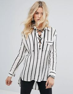 Get this Glamorous's striped shirt now! Click for more details. Worldwide shipping. Glamorous Relaxed Shirt With Lattice Tie Neck In Stripe - Grey: Shirt by Glamorous, Woven cotton, Striped design, Spread collar, Lace-up front, Chest pocket, Stepped hem, Regular fit - true to size, Machine wash, 100% Cotton, Our model wears a UK XS/EU 36/US 4 and is 176cm/5'9.5 tall. An eclectic mix of vintage influences and contemporary partywear are at the heart of Manchester based label Glamorous, where…