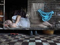 Tens of thousans living in rabbit hutches in Hong Kong, China