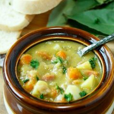 Carrots, onions, potatoes, split peas and ham blend perfectly together in this rich and flavorful soup- the best recipe you'll find and easy to make!