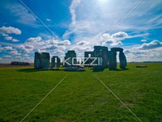 stonehenge - The stonehenge monoliths against the sun on a clear day.