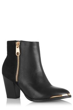The classic chelsea boot gets a slight western makeover this season, and doesn't it look lovely for it
