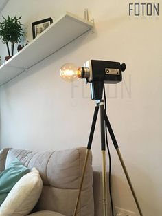Handcrafted lamp made from a vintage (used) Super 8 camera. It comes with a 180 cm long textil cord and integrated touch switch (on/off). The tripod is in the price, but the bulb is not included (E27, max 40w, 220V).  Can be installed with UK or EU plug. If you can not find your country,