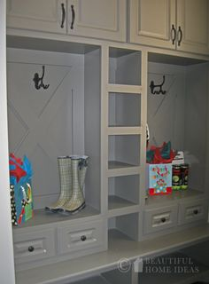 Cabinets above.  Shelves in the middle.  Drawers below bench.  Shoe storage on the bottom!