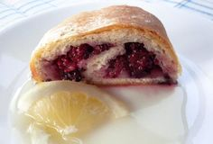 For this roly-poly, fresh blackberries are rolled up jelly-roll style in a milk pastry. A zingy sliced-lemon sauce is serve on the plate as a perfect companion.