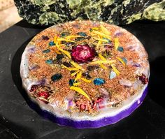 An orgonit charging plate to purify your energetic environment and enhance awareness of subtle energies! This orgonite plate has a straw flower in the center of a crystal grid of amethyst points and blue apatite. Dried sunflowers and peacock ore float over dense layers of brass, copper and bronze. I blended my Shungite EMF Protection blend through the bottom layer of this orgonite plate by drawing Reiki symbols for protection as the resin was curing. The circular grid of amethyst crystals…