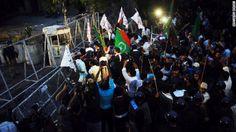 Pakistani Shiite Muslims shout anti-American slogans Monday in Lahore.