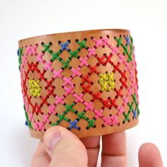 Take a wooden cuff and turn it into something colorful and beautifully unique!