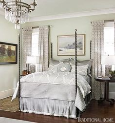 {A scene from the O'More Designer Show House, featured in @Traditional Home's July/August 2013 issue} Dialing down the volume of the day was the aim for Kathleen Evers (class of 1985) when she designed the master suite, which includes an elegant iron four-poster from Ironware International that faces French doors to the terrace.