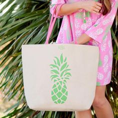 Pineapples are a symbol of hospitality and this simple yet beautifully designed Preppy Pineapple Monogrammed Canvas Tote Bag is ready to graciously help you with your beach, pool and everyday toting needs. www.beaujax.com