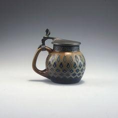 Richard Riemerschmid. Beerstein, 1902. H. 15 cm. Made by Reinhold Merkelbach, Grenzhausen. Stoneware, brown salt glaze, cobalt blue pattern. Not signed.