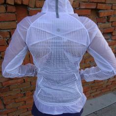 Rare Lululemon mind over matter mesh Jacket So unsure if I want to sell this jacket. It's a rare Lulu piece, only worn 3 times. I love it so much but just don't use it that much. White mesh, reflectors...this jacket rocks  no trades no PP please dont ask! lululemon athletica Jackets & Coats