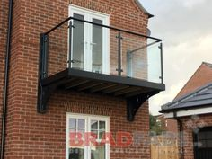 Bradfabs design and manufacture any type of balcony, specialists in glass, stainless steel. Roof Balcony, House With Balcony, Glass Balcony, Glass Pool, Balcony Garden, Covered Patio Design, Balcony Design, Bedroom Balcony, Glass Balustrade