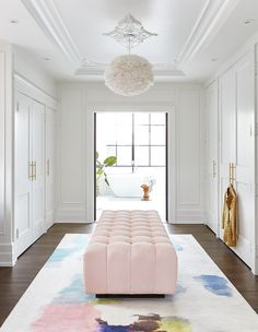 Rooms With The Most Magnificent Rugs : When designing a feminine dressing room, two things are essential: a blush pink ottoman and an equally pretty rug. Dressing Room Decor, Dressing Room Closet, Wardrobe Closet, Closet Space, Dressing Rooms, Walk In Closet Design, Closet Designs, Pink Ottoman, Dressing Room Design