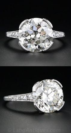 5.50 Carat Art Deco Diamond Ring, A dynamic Art Deco dazzler. A stunning European-cut diamond, weighing 5.50 carats, with a faint, warm sunshiny tinge, is proudly presented in its original, beautifully hand engraved platinum mounting - circa 1920s-30s. The radiant center diamond is highlighted by small accent diamonds set around the gallery and down each shoulder.