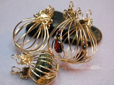 2 Hinged Cages and a Locket - wire wrapping tutorial by MyWiredImagination  ***This listing is for the instructions to make this piece of jewelry, not the actual pieces, materials, or tools. ***  This tutorial teaches you step by step how to create a basic hinged cage, with or without beaded embellishments. This is a wonderfully versatile design to hold a favorite stone, maybe a love note, or a treasured trinket. Once it is on a chain, it is virtually impossible to come open by accident. As…