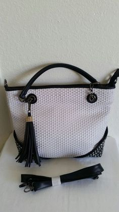New (never used) - Black and white tweed tote with crystals on the corner of each side. Comes with shoulder strap. Brand new.