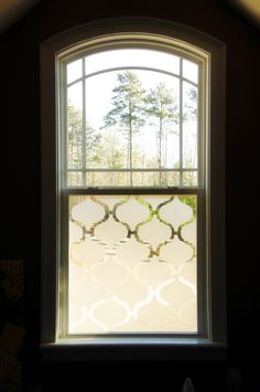 Window Treatment made with contact paper.  Let light in during the day and have better day and night privacy.