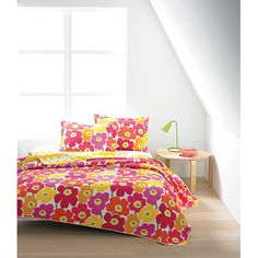 What's better than one of Maija Isola's iconic designs? Two, of course! Marimekko Unikko Pink / Lokki Yellow Quilted Bedding - $29.99 - $200
