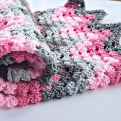 1109715782924681613468 Chevron Crochet Baby Blanket. Love the colors: raspberry, lt. pink, dark grey and light grey.
