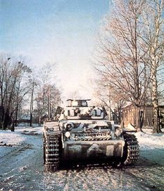 A Pz Kpfw III Ausf. F with very crudely applied winter camouflage (probably white-wash) over Dunkelgrau. Notice how, despite the rather poor application, it does a decent job of breaking up the vehicle's outlines.]