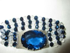 72 carat lab created blue sapphire mounted in silver with hand made  blue and white crystal band
